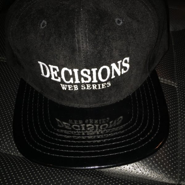 The Official Decisions Web Series Snapback. Features embroidered Decisions Web Series Logo on front. One size fits most. Snapback enclosure on back.